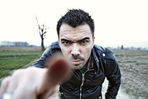 skype-guitar-teacher-in-black-leather-jacket-pointing-his-finger-at-you